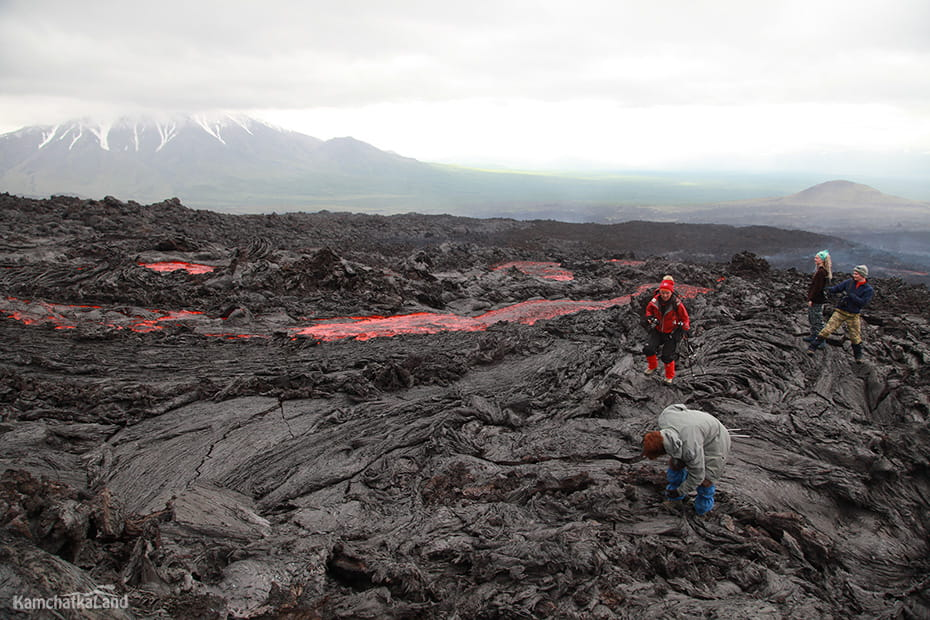 tourists near lava